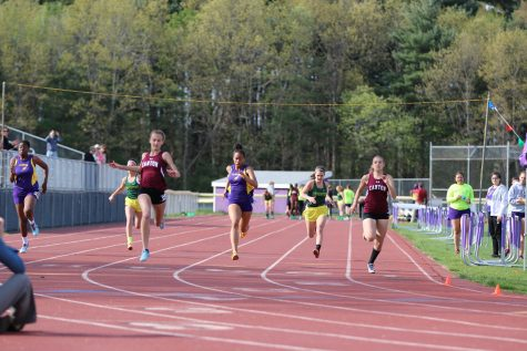 Canton freshman Chelsea Mitchell and senior Emily Mitchell take 1st and 2nd place in the 100 meter dash against Ellington and Coventry. -  photograph by Samantha Brady