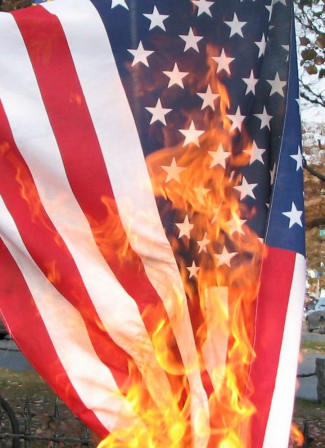Flag burning is protected as freedom of speech under the First Amendment. - photograph by Davepape - Creative Commons Attribution 2.0 Generic license.