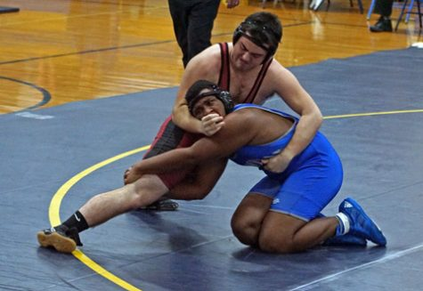 Fluckiger looking to wrap up and pin an opponent in a junior year match. Photo courtesy of Braydon Fluckiger and the Fluckiger family. Used with permission.