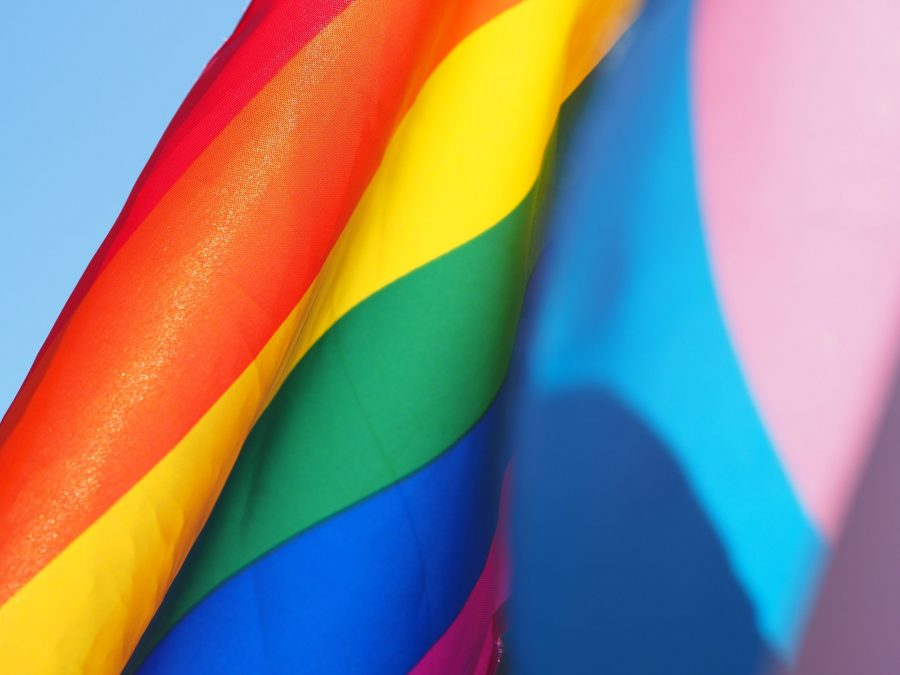 The rainbow flag has long been a symbol for the LGBTQ+ community and its struggles. Cecilie Johnsen/Unsplash