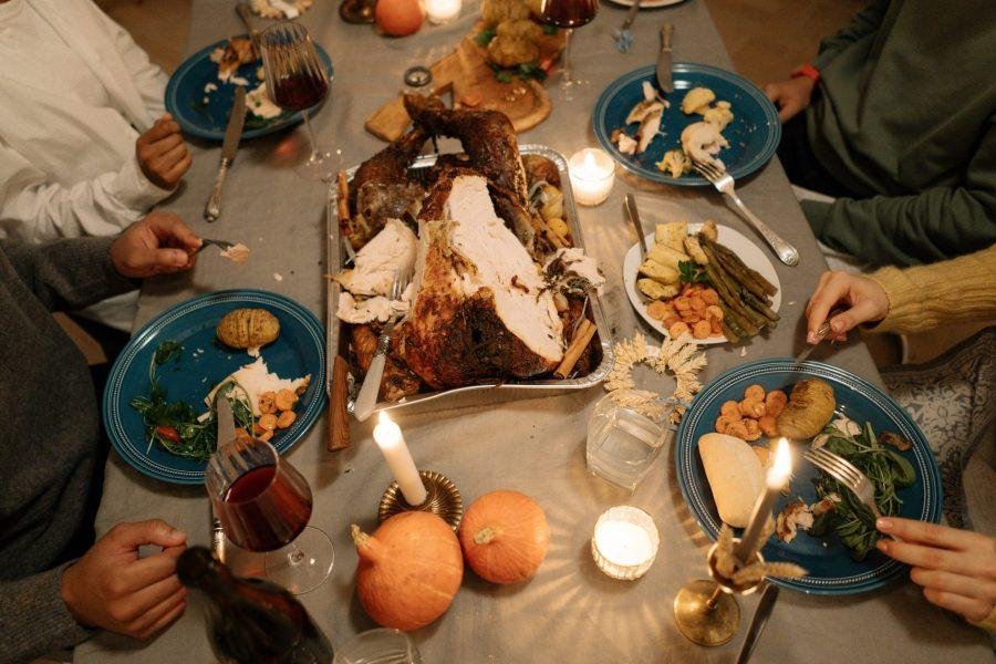 A Thanksgiving gathering, something that will look very different this year due to COVID holiday restrictions. cottonbro/Pexels