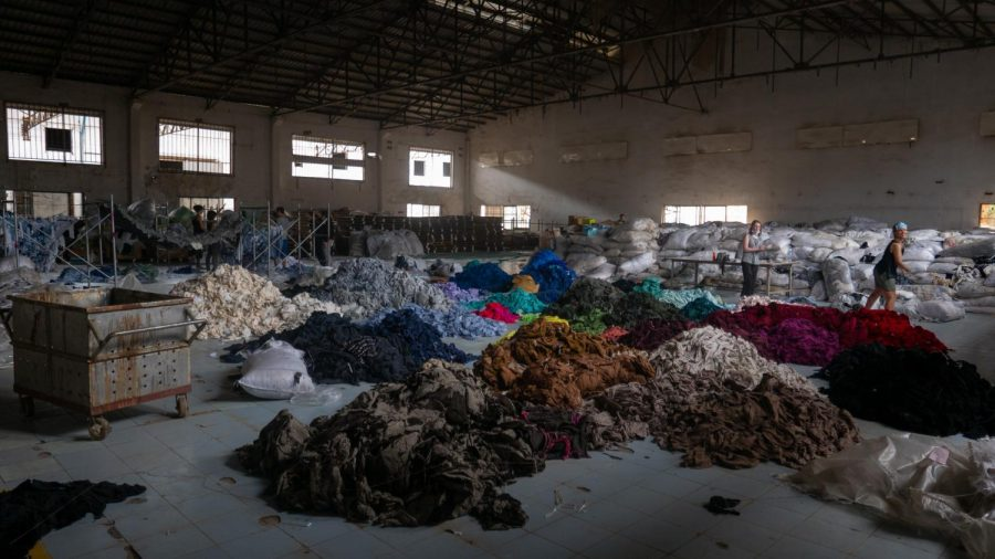 Abandoned clothing  found in Cambodian factory that was eventually used in a political art piece by Clothing the Loop. Francois Le Nguyen/unsplash